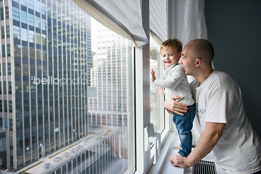 dad & toddler in window of NYC apartment, lifestyle photographers