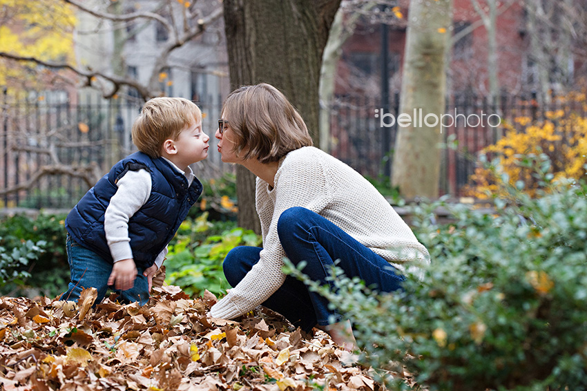 mom & toddler son kiss, nyc park, lifestyle photographer