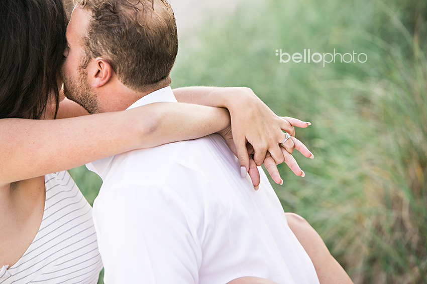 couple kissing in beach grass
