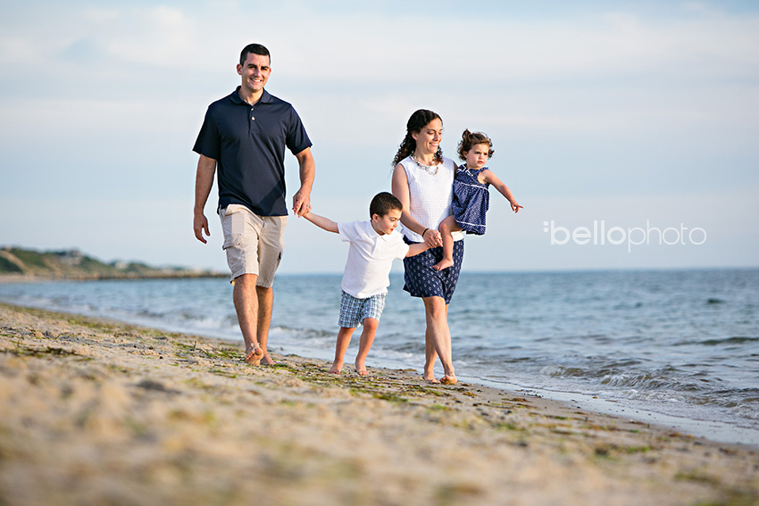 family walking along shore