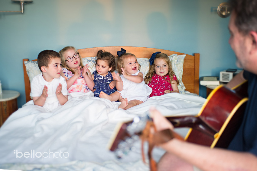 bunch of kids snuggling in bed