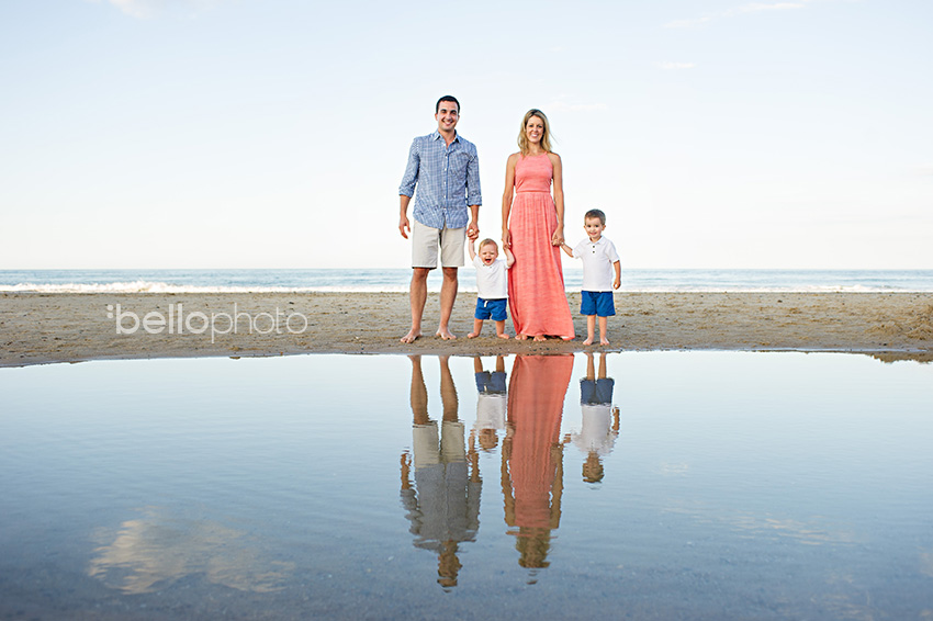 family on beach, reflective pool
