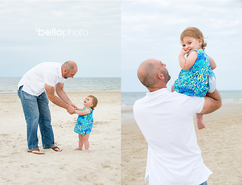 father playing with daughter at beach