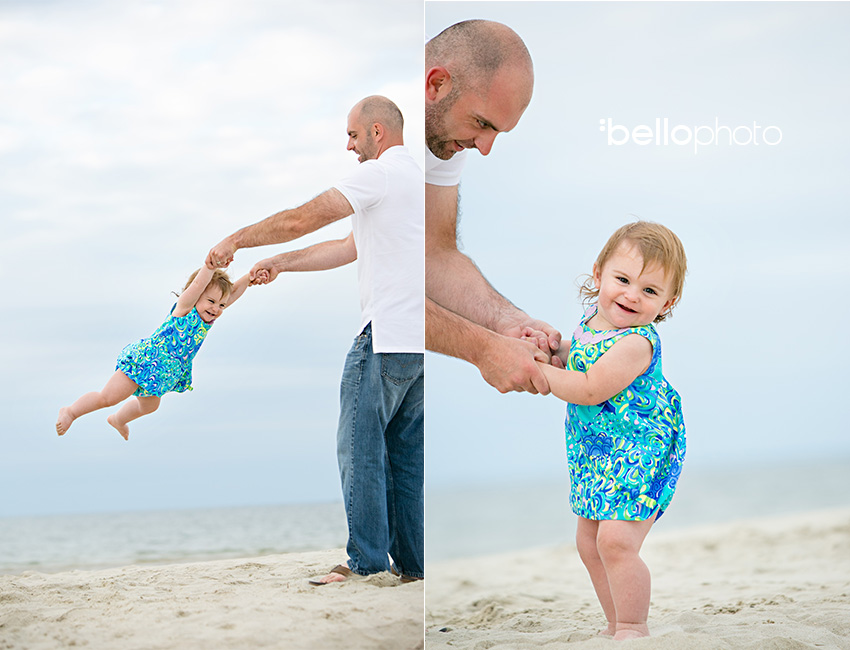 father swinging baby girl at beach