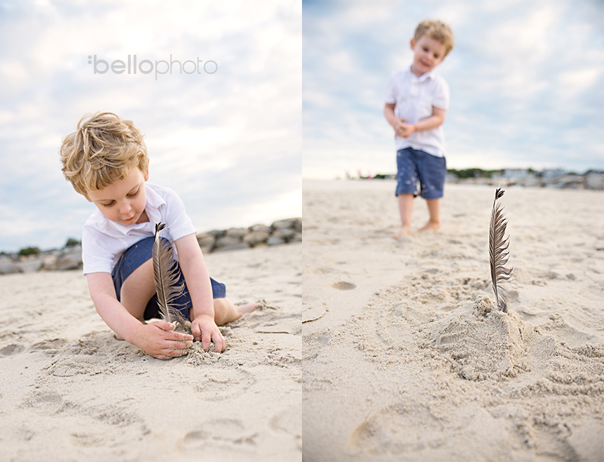 boy playing with feather found at beach