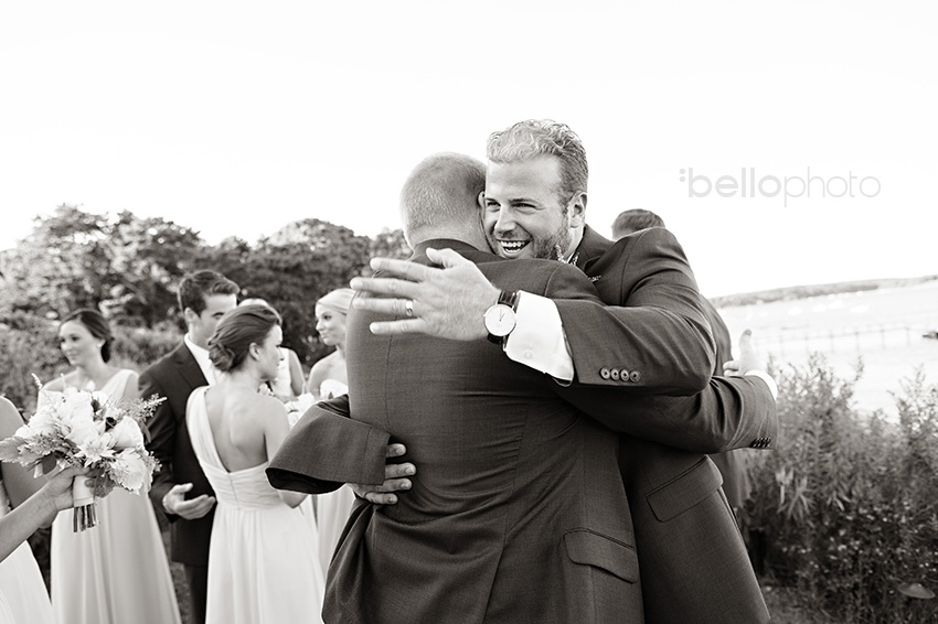 groom & brother hug