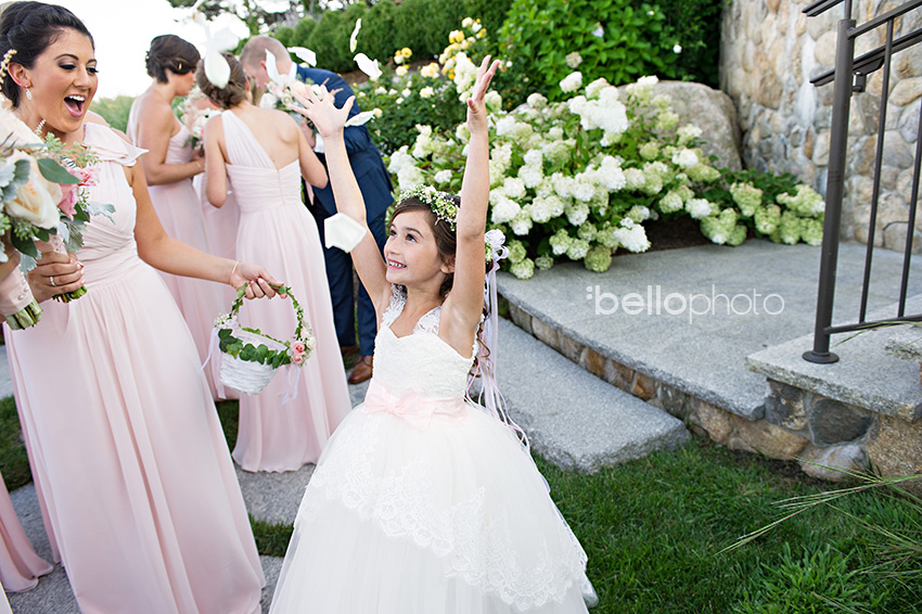 flower girl tosses petals